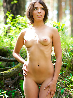Appealing brunette strips her short dress in the woods to show off in all her nude glory