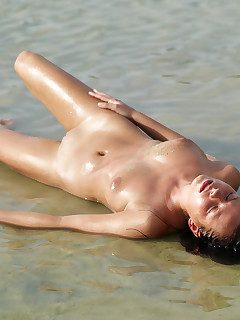 Lysa is naked on the beach
