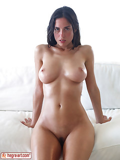 Busty Muriel relaxes naked