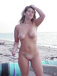 Babe getting naked on the beach has a freakish big clits