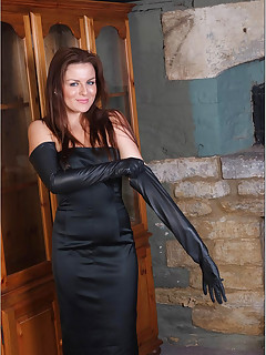 Sexy brunette with great tits shows off her leather gloves