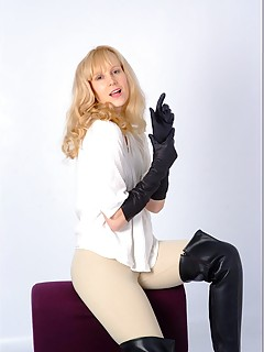 Sexy Femdom Milf Ariel is in her full riding gear with leather gloves and boots on and ready to give you a good whipping