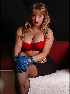 Hot blonde Elle takes off her sexy red bra and holds her big juicy tits with her blue leather gloves on