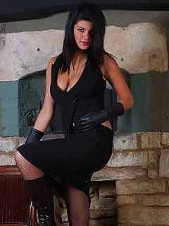 Hot brunette Heather pops her big boobs out whilst wearing sexy leather gloves and boots