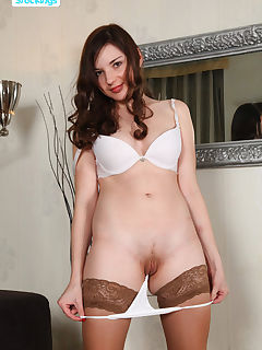 Sexy doll poses in stockings and little panties