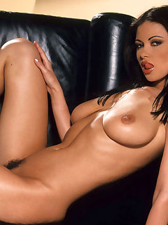 Veronika Zemanova is smothering hot as she sheds her tan leather suit and poses on a black couch