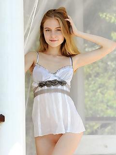 Sweet and youthful Shayla enjoys basking nude in the morning sun