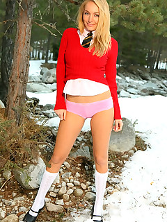 Cute blonde looks amazing in red college miniskirt and white knee socks