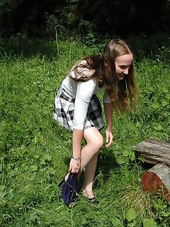 Teen schoolgirl sits down for an outdoor piss